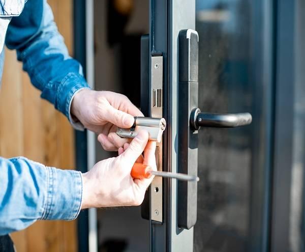 Locksmith changing Euro Cylinder on door